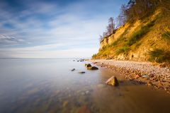 Beautiful Baltic sea shore with big cliff in Gdynia Orlowo. Royalty Free Stock Photography