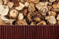 Beautiful bamboo mat on dry mushroom as agricultural background. Stock Photography