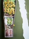 Beautiful banana bunch in traditional little wooden boat in floating market in Damnoen Saduak, Thailand Stock Image