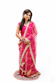 Beautiful Bangali bride. In colorful dress standing, isolated Stock Image