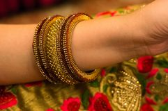 Beautiful bangles on the arm of indian lady Royalty Free Stock Image
