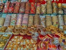 Beautiful bangles for women at street market. Beautiful and colorful bangles for women at street market royalty free stock photos