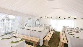 Beautiful banquet hall under a tent for a wedding reception.  stock video