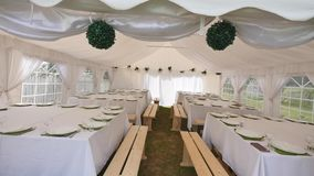 Beautiful banquet hall under a tent for a wedding reception