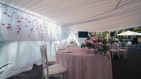 Beautiful Banquet hall under a tent for a wedding reception. stock footage