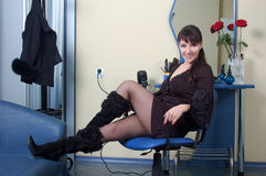 Beautiful  barber relaxing at workplace Stock Photo