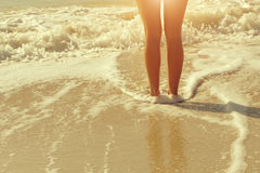 Beautiful bare feet on the beach Stock Photography