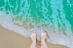 Beautiful bare feet on the beach Stock Photos