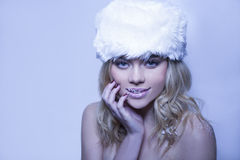 Beautiful bare shouldered woman in a winter hat Stock Image