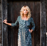 Beautiful barefoot blondie near old wooden house Stock Photo