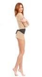 A beautiful barefoot girl with long beautiful legs Royalty Free Stock Photo