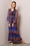 Beautiful barefoot  woman in long blue dress. Stock Image