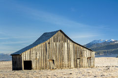 Beautiful barn with Idaho mountains in winter Stock Photography