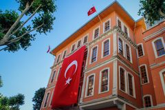 Beautiful baroque building with a huge Turkish flag on the facade. stock images