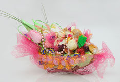 Beautiful Basket with Candies and Flowers Stock Photography
