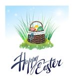 Beautiful basket with Easter eggs on the grass. Vector illustration. Beautiful lettering Happy Easter. Beautiful basket with Easter eggs on the grass Royalty Free Stock Photography