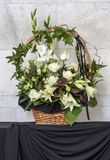 Beautiful basket of flowers, funeral bouquet. Vertical stock image