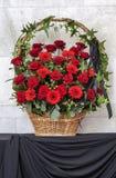 Beautiful basket of flowers, funeral bouquet. Vertical stock photos