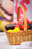 The beautiful basket with vegetables, fruit is on sale at fair. Royalty Free Stock Photography