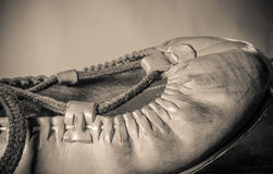 Beautiful basque dancing leather shoe close up on light brown background isolated top view in sepia vintage retro macro. Beautiful basque dancing leather shoe Stock Image