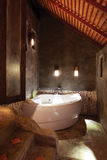 Beautiful bathroom with bathtub with cement wall and warm light Royalty Free Stock Photos
