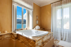 Beautiful bathroom with jacuzzi Stock Photos