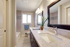 Beautiful bathroom with tile floor. Royalty Free Stock Image