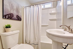 Beautiful bathroom with white theme. Royalty Free Stock Photography