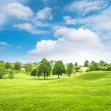 Beautiful bavarian countryside landscape. Green field and blue s Royalty Free Stock Image