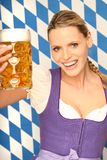 Beautiful bavarian girl with beer. Beautiful blond bavarian girl holding a big beer stock image