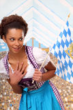 Beautiful bavarian girl with a flag Stock Image