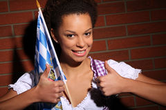 Beautiful bavarian girl with a flag Royalty Free Stock Image