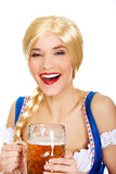 Beautiful bavarian woman with beer. Happy laughing beautiful bavarian woman with beer Stock Images