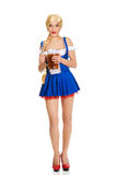 Beautiful bavarian woman with beer. Young and beautiful bavarian woman with beer Royalty Free Stock Images