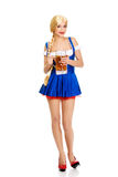Beautiful bavarian woman with beer. Royalty Free Stock Photos