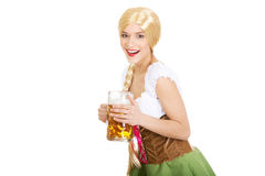 Beautiful bavarian woman with beer. Stock Photos