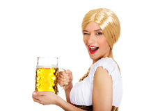 Beautiful bavarian woman with beer. Royalty Free Stock Photography