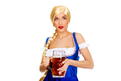 Beautiful bavarian woman with beer. Royalty Free Stock Images
