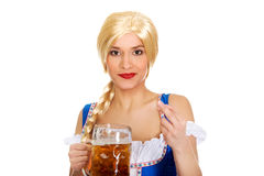 Beautiful bavarian woman with beer. Stock Photography