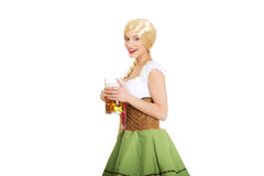 Beautiful bavarian woman with beer. Royalty Free Stock Photo