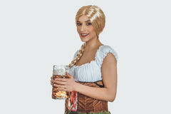 Beautiful bavarian woman with beer. Stock Image