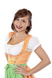 Beautiful, Bavarian woman in Dirndl smiles happy royalty free stock images