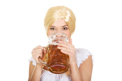 Beautiful bavarian woman drinking beer. Stock Image