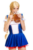 Beautiful bavarian woman drinking beer. Royalty Free Stock Photos