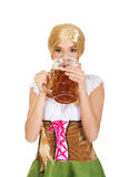 Beautiful bavarian woman drinking beer. Royalty Free Stock Photo