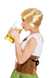 Beautiful bavarian woman drinking beer. Royalty Free Stock Image
