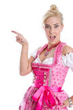Beautiful bavarian woman isolated making promotion for Oktoberfe Royalty Free Stock Photography