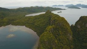 The beautiful bay aerial view. Tropical islands. Tropical bay in El Nido.Aerial view: bay and the tropical islands. Tropical landscape.Sky and mountains rocks stock footage