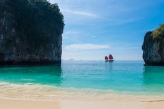 Beautiful bay in the Andaman Sea. View of the yacht with sails from the island of Hong, Thailand royalty free stock photo