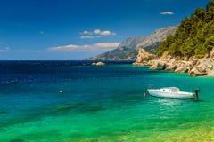 Beautiful bay and beach with motorboat,Brela,Dalmatia region,Croatia. Stunning summer landscape with Adriatic Sea,Biokovo mountains and wonderful bay,Brela beach royalty free stock photos